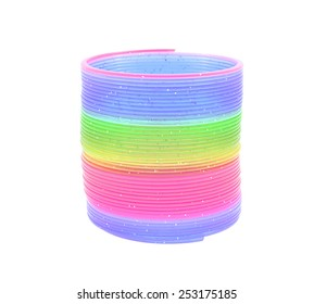 Minsk, Belarus - February 9, 2015: Multi-Colored Rainbow Spring Toy Isolated on White Background.