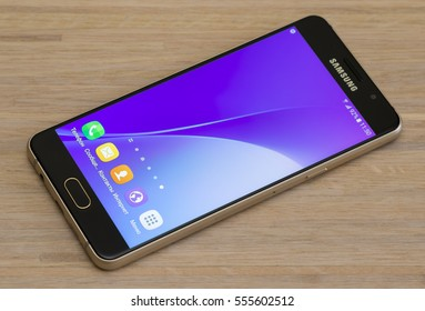"""Minsk, Belarus - Jan 10, 2017: Samsung Galaxy A5 (2016) gold smartphone, with 5.2"""" display, Android v6.0.1, Quad-core 1.2 GHz Cortex-A53 , 13 Mp Camera. Selective focus with shallow depth of field."""