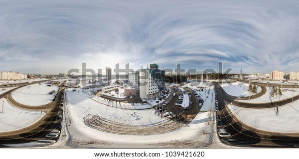 MINSK, BELARUS - JANUARY 14, 2017:  Aerial 360 angle panorama view over the winter city in sunny day. Full 360 by 180 degrees seamless equirectangular equidistant spherical panorama. vr ar content