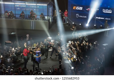 MINSK, BELARUS - JANUARY 17, 2016 Starladder iLeague championship Dota 2 and Counter Strike Global Offensive. Team Alliance leaving the stage with the champions bowl