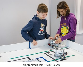 Minsk, Belarus. January, 2019. Boys and girls construct and code robots. Lego Mindstorms EV 3 robot. STEM education.   Robotics class for child and teen. STEAM. Mathematics. Science. Technology. Art.