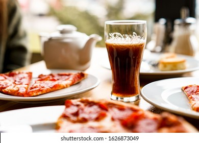 MINSK, BELARUS - JANUARY, 2019: Glass with coca cola and delicious pepperoni pizza