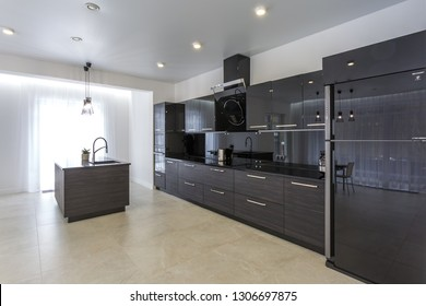 MINSK, BELARUS - JANUARY, 2019: Interior of the modern kitchen  and guest hall in loft flat in minimalistic style with black color