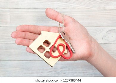 Minsk, Belarus. January, 2019. The key to the apartment or house with the key pendant in the form of the logo of the famous international rental company Airbnb for travelers. The idea of business.