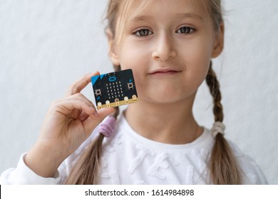 Minsk, Belarus. January, 2020. The BBC robot Micro Bit is connected to a computer. A cute little girl is programming it on Scratch and Python. Creative. Connected. Coding. Learning, teaching easy.