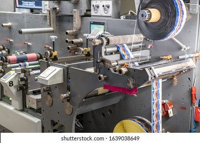 MINSK, BELARUS - JANUARY 2020: Rows of Large offset printing press. moving polymer label conveyor typography facility and flexographic printing