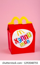 Minsk, Belarus - January 21, 2019: Happy Mile Red Box for McDonalds. On sale since June 1979. Each box contains juice, a hamburger or McNuggets, french fries and a toy.