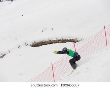 MINSK, BELARUS - JANUARY 26, 2019: Belarus freestyle championship among boys and girls born in 2001 and younger in the Sport Complex Raubichi. freestyle skiing acrobatics