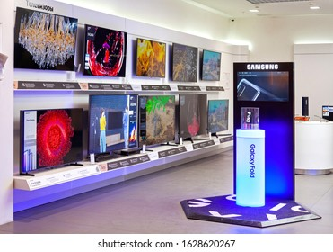 MINSK, BELARUS - January 27, 2020: Samsung Galaxy Fold 5g and Samsung TVs a branded store.