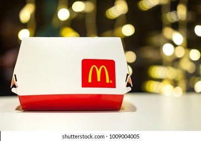 Minsk, Belarus, January 3, 2018: Big Mac Box with McDonald's logo on table in McDonald's Restaurant