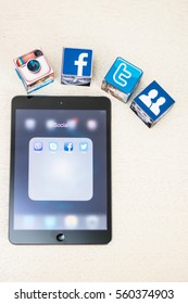 Minsk, Belarus - January 5, 2016: Apple iPad is on the table with a tab open social networks: Facebook, Twitter, Vayber, Skype. Facebook, Twitter, Instagram logoes on the dice.