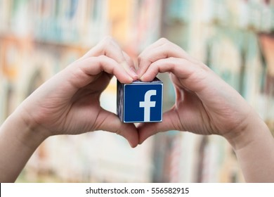 Minsk, Belarus - January 5, 2016:The most popular social network in the world. Facebook logo in the hand.  Heart.