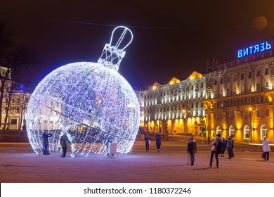 Minsk, Belarus - january 9, 2018: Celebration decorations and lights on the square in festive Minsk for Christmas and New Year. Night city landscape of winter Minsk.