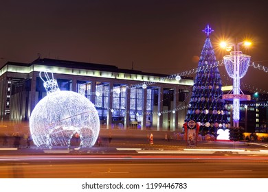 Minsk, Belarus - january 9, 2018: Night Minsk in Christmas and New Year time. Decorated christmas tree on general square. Celebrations in Belarus. Festive illuminations and decorations in evening city