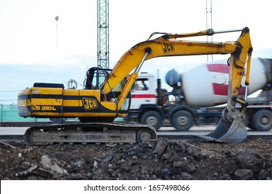 Minsk, Belarus, Jul 11, 2019: Excavator JCB JS 210 L working at construction site. Construction machinery for excavation, loading, lifting and hauling of cargo on job sites
