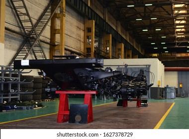 """MINSK, BELARUS JUL 27, 2019: MZKT-7930 chassis (8x8) on assembly line of the Minsk Wheel Tractor Plant (Volat trademark) for air defence missile system: S-300, S-400 """"Triumph"""",  MLRS """"Polonez"""""""
