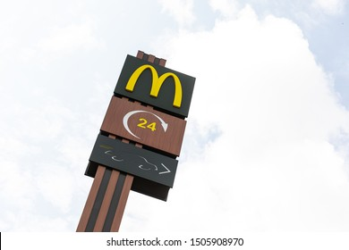 Minsk, Belarus - July 17, 2019: McDonald's fastfood restaurant logo on board. McDonald's is a famous american fast food restaurant which serves exellent burgers, free fries and mcflurry ice-cream.