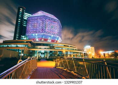 MINSK, BELARUS - JULY 19, 2014: Unique Building Of National Library Of Belarus In Minsk At Night Scene. Building Has 23 Floors And Is 72-metre High. Library can seat about 2,000 readers.