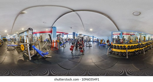 MINSK, BELARUS - JULY, 2017: full seamless panorama 360 by 180 angle view in interior of big stylish fitness club with sports equipment and simulators in equirectangular projection, skybox VR content