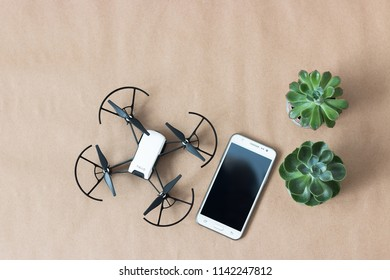 Minsk, Belarus. July, 2018. Flat lay   with quadrocopter Tello DJI, Samsung smartphone, succulents. Toy for children. Robot for STEM education.