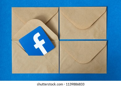 Minsk, Belarus. July, 2018. Logo of the famous social network Facebook well known all round the world. Communicate with friends. Blue background. Succulents. Concept of massage and letter in envelope.