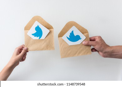 Minsk, Belarus. July, 2018. Logo of the famous social network Twitter well known all round the world. Communicate with friends. Blue background. Succulents. Concept of massage and letter in envelope.
