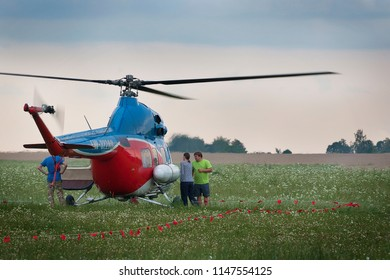 Minsk, Belarus. July 21, 2018. Man and a woman arrange an excursion on a small blue-red helicopter