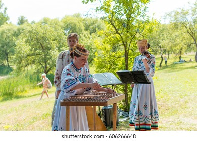 MINSK, BELARUS - July 5, 2015: Musicians in national suits plays music and celebrate traditional slavic holiday of Belarus Ivan Kupala. Midsummer.