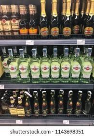 Minsk, Belarus - July 6, 2018: Glass bottles with liquor on shelves in supermarket of various manufacturers.