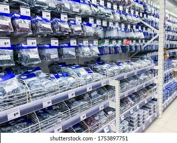 Minsk, Belarus - June 05, 2020: Nails, bolts, screws in packages of various manufacturers, sale in a hardware store.