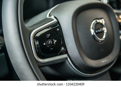 MINSK, BELARUS - JUNE 1, 2018: Volvo XC90 on a display at dealer's showroom in Minsk, Belarus. Photo of the interior, close up image of a steeting wheel with cruise control buttons.