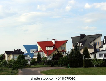 Minsk. Belarus. June 10, 2019. The elite district of the capital is built up with bright multi-colored houses with cottages with a tiled roof. Luxury real estate suburban.