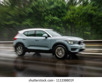 Minsk, Belarus - June 15, 2018: Blurry image of Volvo XC40 on a highway during rainy summer day. Volvo XC40 is the first subcompact SUV by Volvo.