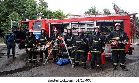 MINSK, BELARUS - JUNE, 2015: fire fighters posing in front of fire truck