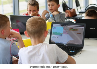 Minsk, Belarus. June, 2017. Teenager boy constructs and programmes Lego Robot Mindstorms EV3 at robotics school. Education of children and teenagers. Competition. Stem education.