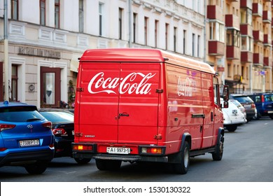 Minsk, Belarus - June 2019. Coca Cola branded van riding on road through the center of old city. Food and Drinks delivery from distributor to restaurants. Mercedes-Benz Vario, red Coca-Cola truck