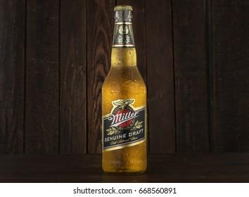 MINSK, BELARUS - JUNE 29, 2017: Miller Genuine Draft Beer on wooden background. Miller is the original cold filtered packaged draft beer, a product of the Miller Brewing Company owned by SABMiller.