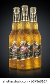 MINSK, BELARUS - JUNE 29, 2017: Editorial photo of bottles Miller Genuine Draft Beer with drops isolated on black. Miller is the original cold filtered packaged draft beer.