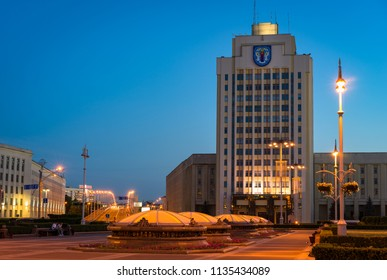 Minsk, Belarus - June 3 2018: Independence Square illuminated in the evening with Belarusian State Pedagogical University named after Maxim Tank and small domes of the underground shopping center