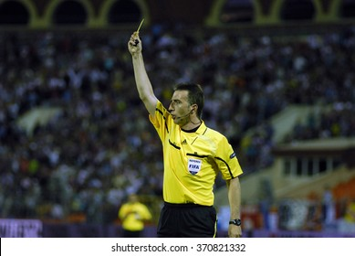 MINSK, BELARUS - JUNE 3: Referee shows yellow card duringthe Euro 2012 qualifying match between Belarus and France on june 3, 2011 in Minsk, Belarus
