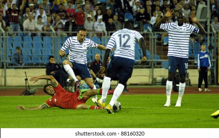 MINSK, BELARUS - JUNE 3:Timofei Kalachev(L)of Belarus fights for the ball with Franck Ribery(2L) of France during the match between Belarus and France on June 3, 2011 in Minsk, Belarus