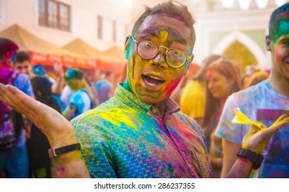 MINSK, BELARUS   JUNE 7: unidentified guy celebrates holi festival in park Dreamland on June 7, 2015  in Minsk, Belarus. The name of the festival is Colorfest