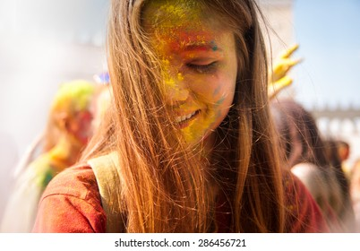 MINSK, BELARUS - JUNE 7: unidentified girl celebrates holi festival in park Dreamland on June 7, 2015  in Minsk, Belarus.  The name of the festival is Colorfest
