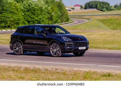 MINSK, BELARUS - JUNE 9, 2018: Black Porsche Cayenne S 2018 (third generation) powered by twin-turbo V6 engine producing 440 hp drives on a road during test drive.