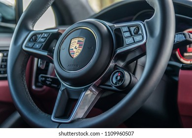 Minsk, Belarus - June 9, 2018: Photo of multifunction sports steering wheel of Porsche Cayenne S 2018 (third generation) with gearshift paddles that enable sporty, fast, ergonomic shifing.