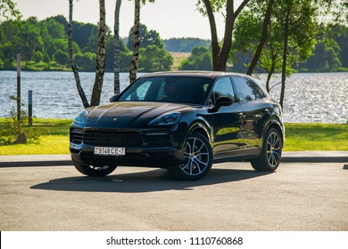 MINSK, BELARUS - JUNE 9, 2018: Black Porsche Cayenne S 2018 (third generation) powered by twin-turbo V6 engine producing 440 hp stopped on a parking during test drive.