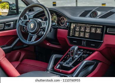 Minsk, Belarus - June 9, 2018: Photo of two-tone Black and Bordeaux Red with Anthracite Chestnut trim with aluminium inlay interior of the newest Porsche Cayenne S 2018 (third generation).
