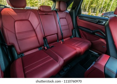 Minsk, Belarus - June 9, 2018: Photo of rear seats of two-tone Black and Bordeaux Red interior of Porsche Cayenne S 2018. The rear seats are comfortable and sporty, they can moved 160 mm.