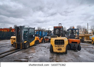 Minsk, Belarus. Mar 2019. Forklift rental service. Different forklifts on the yard. Warehouse of industrial equipments