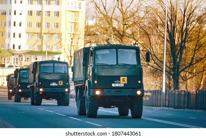 Minsk, Belarus. Mar 2020. Military trucks Maz on the road. Soldiers transporting in military trucks convoy. Military preparing equipment for the parade in the city.